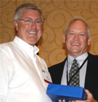 Jeff Hayslett, AMVAC Chemical, accepted the Dean Roy Achievement award from MACA President Matt Wagner.