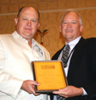 2010-2011 President David Flakne presents 2011 Ambassador of the Year Award to Dave Case, Bayer CropScience